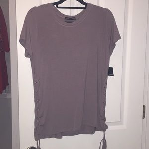 Taupe blouse with side tie detail.
